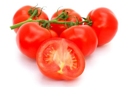 cherry tomatoes: Fresh red organic tomatoes on the vine                                Stock Photo