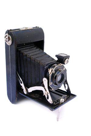 Old vintage black camera on white background                                 photo