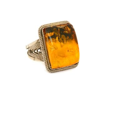 Ring with amber on a white background                                photo