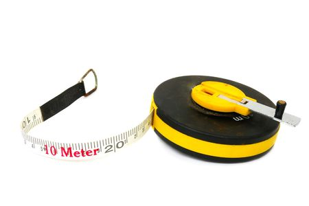 Measuring tool a roulette isolated on a white background                                photo