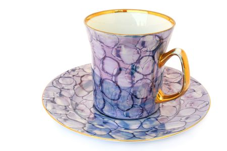 Tea cup and saucer on white background                                photo