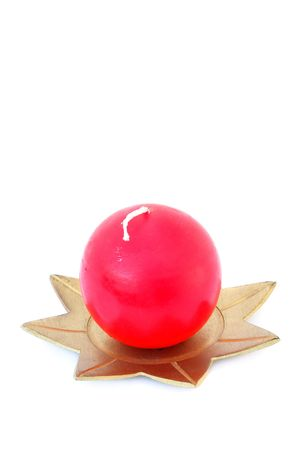 Round red candle  isolated on the white background                                 photo