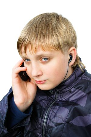 speaks: The boy speaks by phone  isolated on the white background