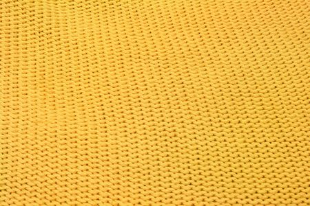 Home knitting yellow texture as background                               photo