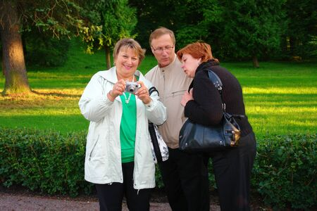 Tourist taking pictures in a city park Stock Photo - 9123182