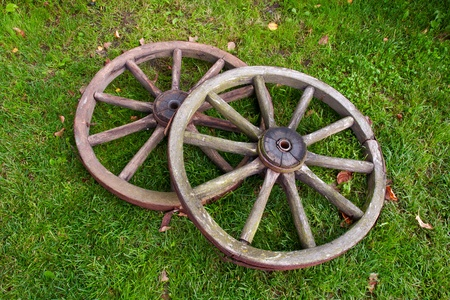 wood agricultural: Two old broken wheel from vintage cart