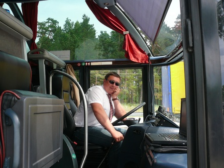 race car driver: The young bus driver on the roads of Lithuania  Stock Photo