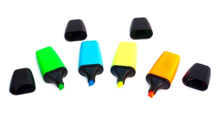 Colored markers isolated on a white background photo