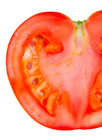 Slice of tomato isolated over the white background photo