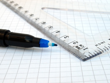 Ruler, pen and notebook on white background photo