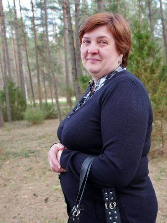 Portrait of a mature woman in the park photo