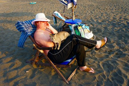 Elderly man is relaxing at the tranquil beach Stock Photo - 11015728
