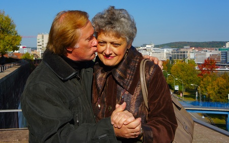 Portrait of middle-aged couple on a background of the urban landscape photo