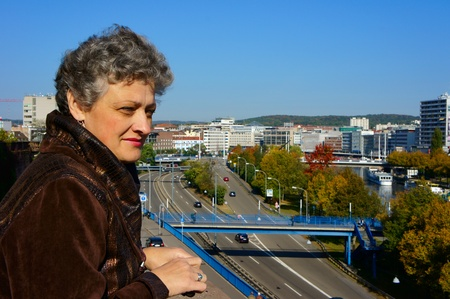 Portrait of middle-aged women against the background of the urban landscape Stock Photo - 11536605