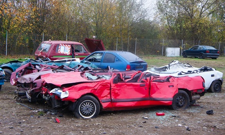 discarded metal: Car cementary with many broken cars in the autumn Stock Photo