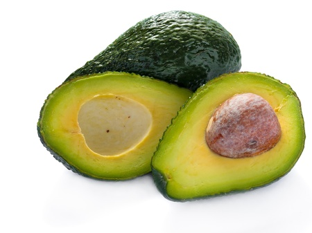 Avocado cut in half against white background Stock Photo