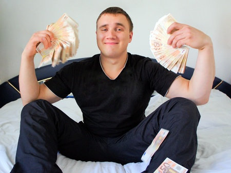 Portrait of a young business man holding money photo