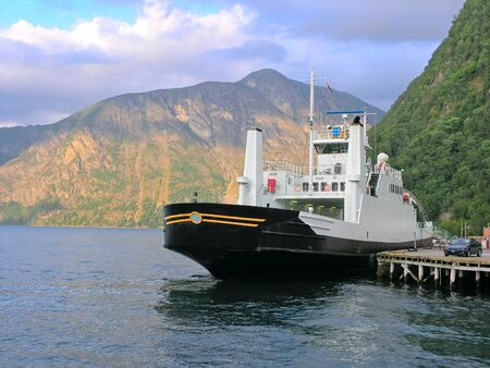 The ferry on the lake in the mountains of Norway Stock Photo - 14590056