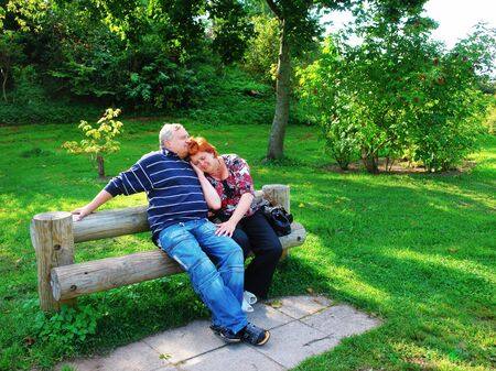 Happy elderly couple talking in the park                                Stock Photo