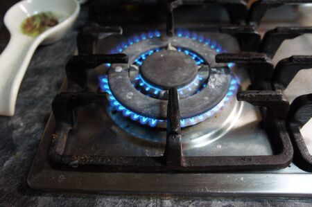 Blue gas flame on the hob close up                               photo
