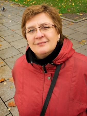 Portrait of a middle-aged woman in a red jacket