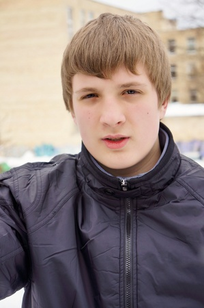 manful: Portrait of a handsome guy in a  jacket. Blond hair.