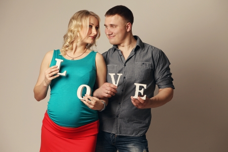 Portrait of a happy young pregnant woman with her husband photo