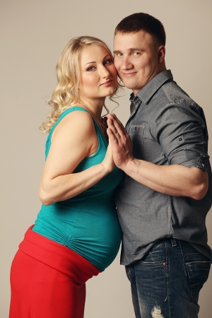 Bright portrait of pregnant woman with her husband