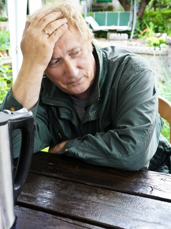 Closeup of an elderly man lost in thought , loneliness Stock Photo
