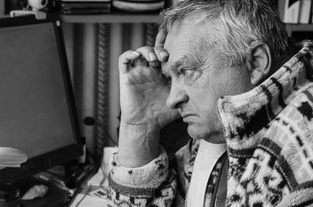 Monochrome stylized portrait of an expressive old man photo