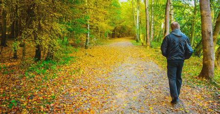 Old man outdoors. Autumn time photo