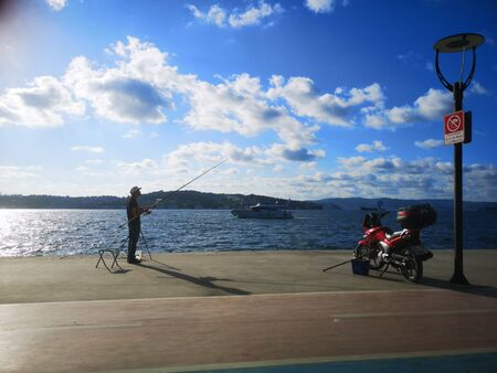 Man fishing from the beach Stok Fotoğraf