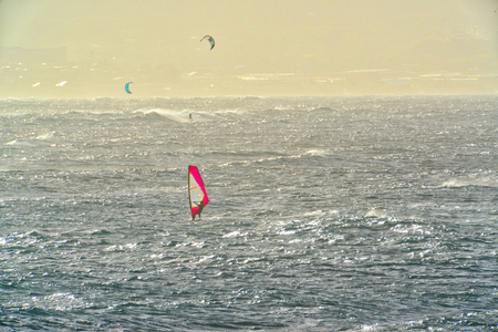 Red Windsurf Sail and Ocean