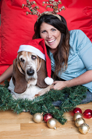 Basset Hound and attractive female get into the festive sprirt! photo