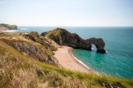 durdle door: The South West Coastal Path, Dorset. Durdle Door. Part of The Jurassic Coastline of England.
