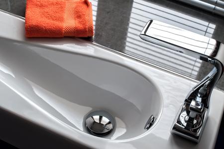 en suite: Contemporary wash hand basin with orange towel