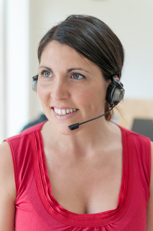 Businesswoman talking on headset in office photo