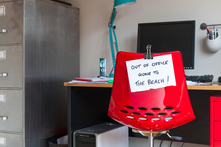 Employee leaves note on back of office chair: Out of Office. Gone to The Beach! photo