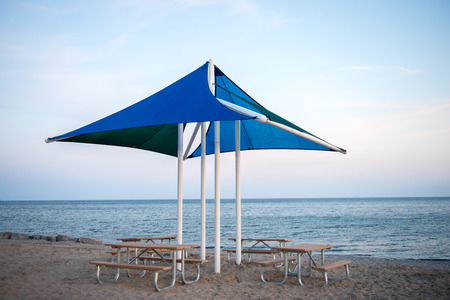 Picnic Benches and Umbrella at the Beach photo