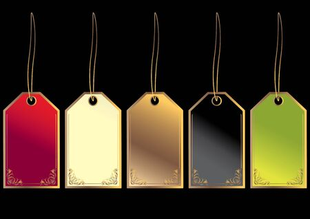 Gift tags blank with gold embellishment isolated on a black background