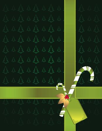Green ribbon and candy cane with gift tag on a pine tree patterned background Stock Photo