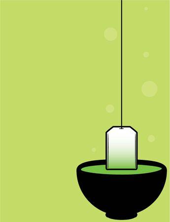 Black teacup with teabag on a green background Reklamní fotografie