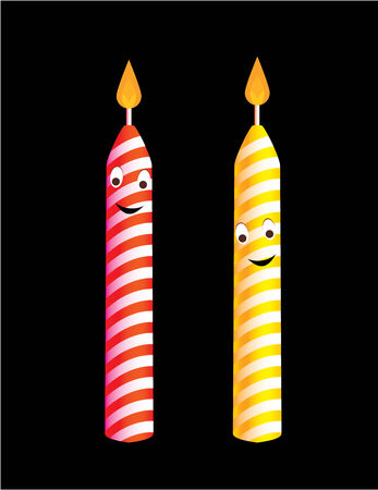 Two birthday candles with cheerful smiles and flames isolated on a black background