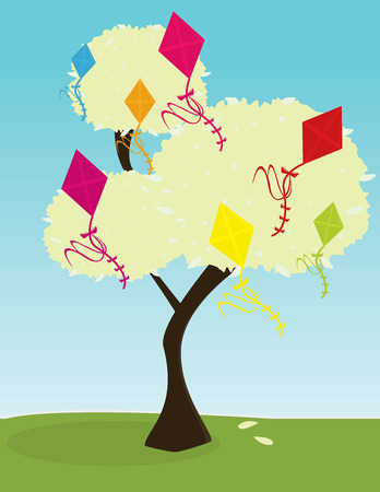 Tree with brightly colored kites in its leaves