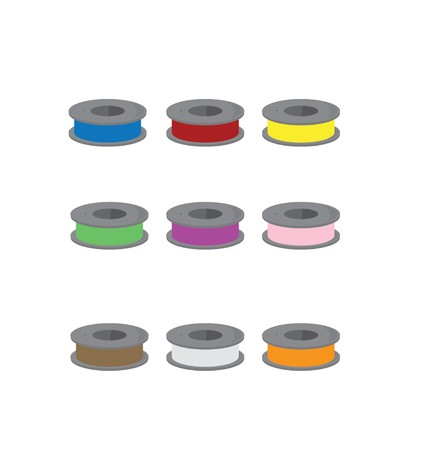 Bobbins with different colors of thread on a white background