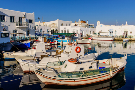 cycladic: Paros island, Greece - MAY 31: a multicoloured boats and promenade in the traditional Cycladic style in MAY 31, 2015, Naoussa village, Paros island, Cyclades, Greece.