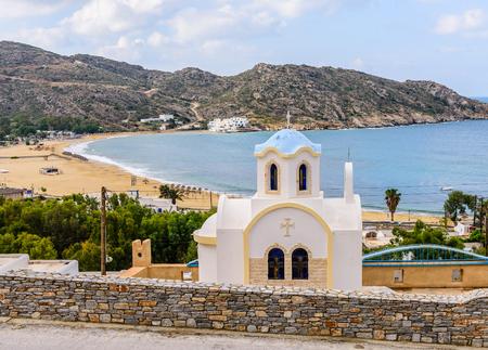 ios: Greek Orthodox Church on a high hill, Mylopotas beach, IOS island, Cyclades, Greece.