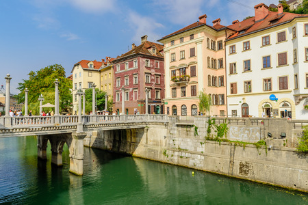 Ljubljana, Slovenia - September 10, 2016: a view of the picturesque embankment of the Ljubljanica river with beautiful old houses.
