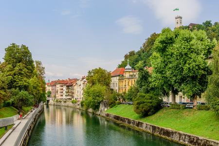 Ljubljana, Slovenia - September 10, 2016: a view of the picturesque embankment of the Ljubljanica river and Ljubljana castle.