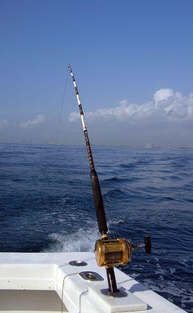 sportfishing: A rod and reel. taken while sportfishing off Florida coast.